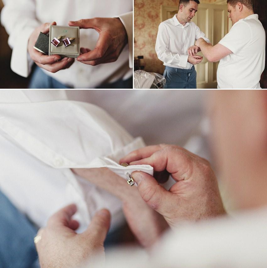 groom puts on wedding cuffs
