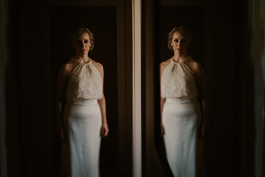 alternative wedding photo of Bride and reflection in the mirror
