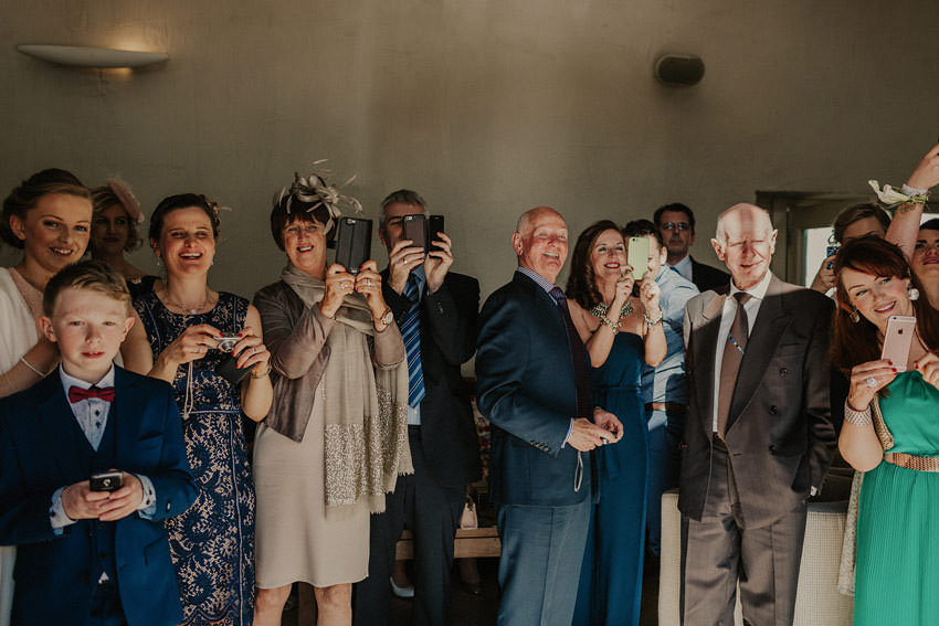 wedding guests greet wedded couple in coach house lounge