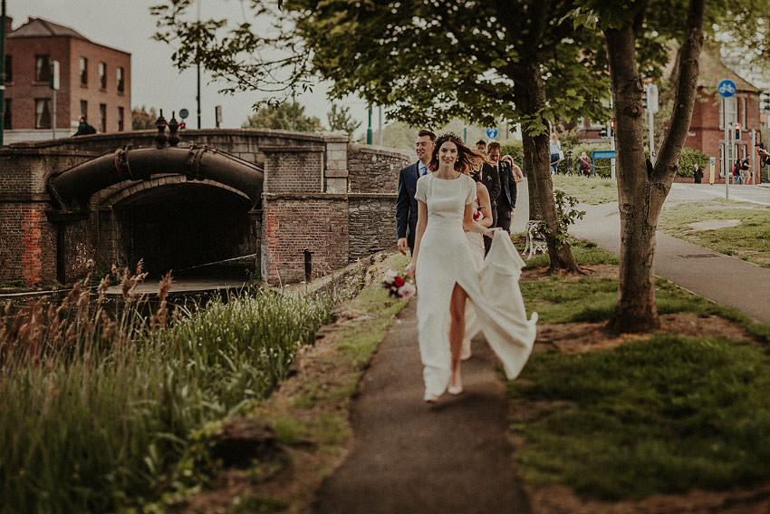 Lynda is walking at the bridge windy day