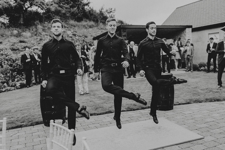 traditional irish dancers at house garden wedding