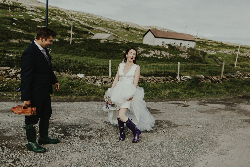 wedding on the inishturk island. Funny moment when bride shows her wellies to all guests