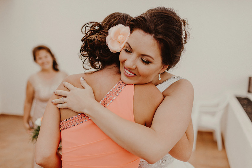 Elena hugs her birdesmaid