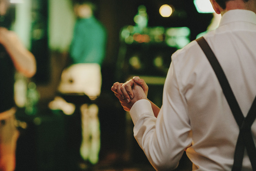 couple holding hands on the dancefloor
