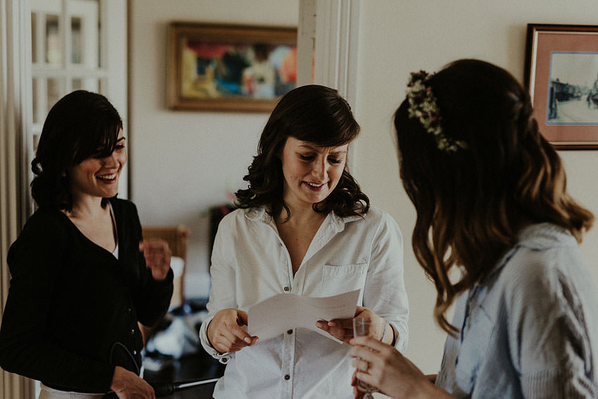 bridesmaids are reading a letter