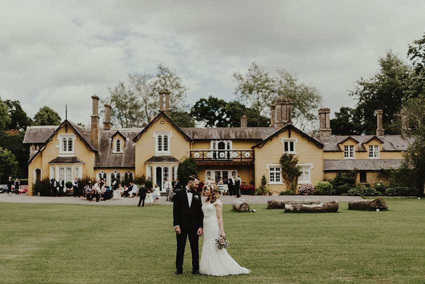 martinstown house wedding barry and kim with the house in the background