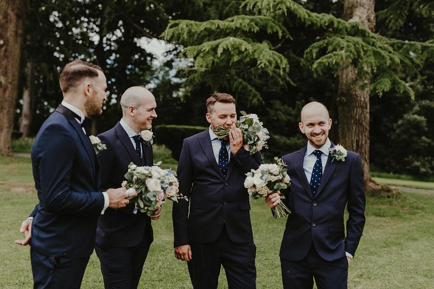 groomsman trying to eat flowers wedding fun