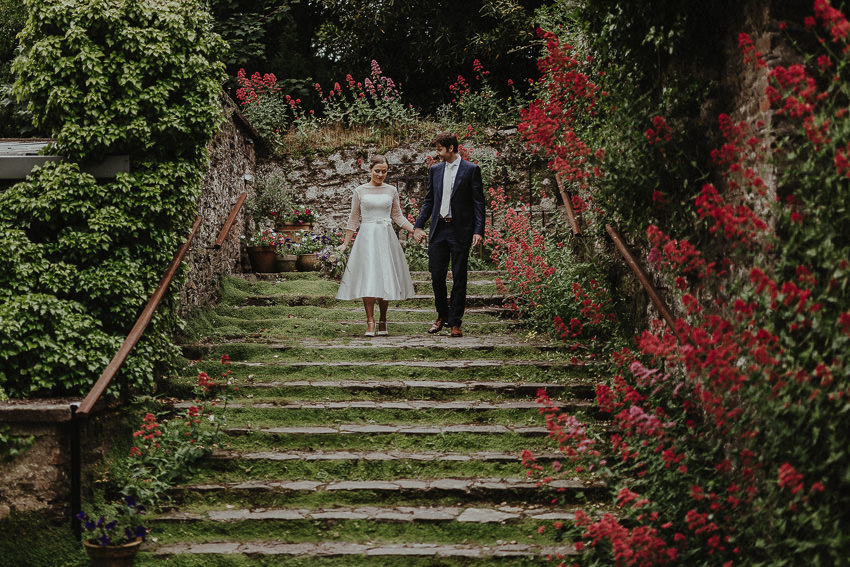 Barnabrow-house-east-cork-wedding-couple-on-the-green-stairs