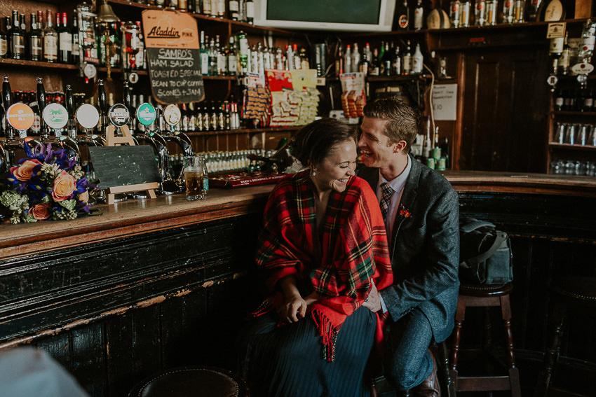 elopement-enjoying-guinness-in-old-irish-pub