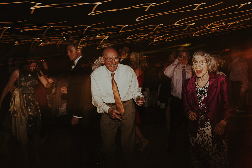 older-couple-dances-on-the-dancfloor-and-blows-everyone