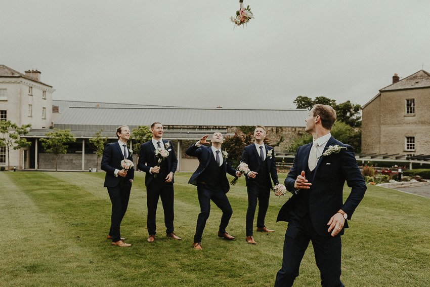 the groom throws the bouquet