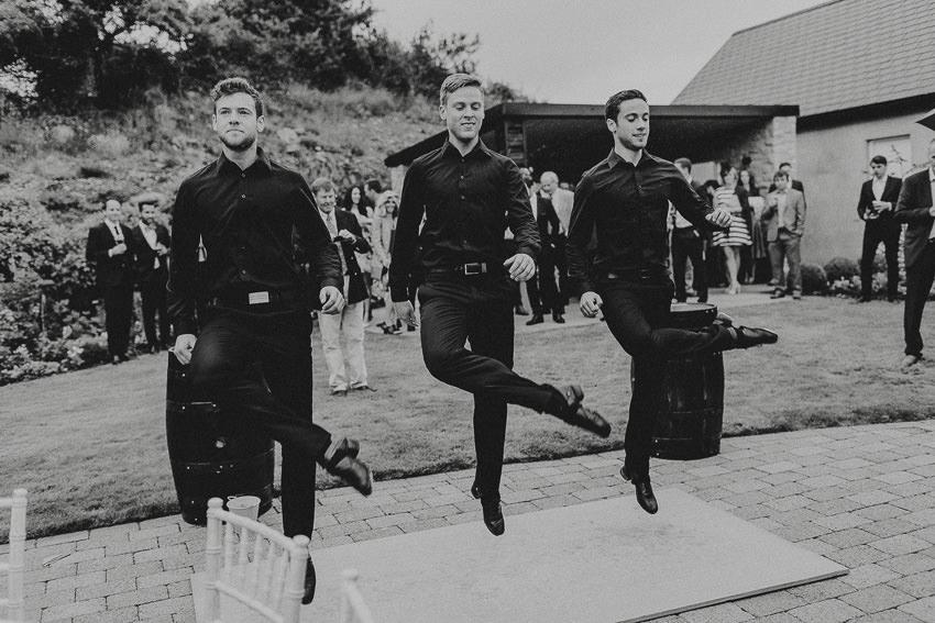 traditional irish dancers at house garden wedding