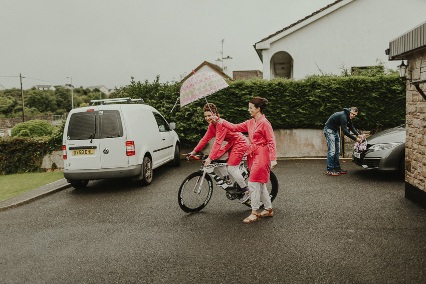 Aine on the bicycle with umbrealla