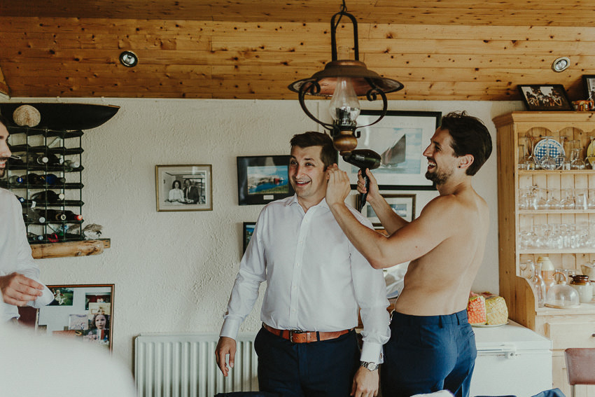 grooms brother helps him with hairdryer