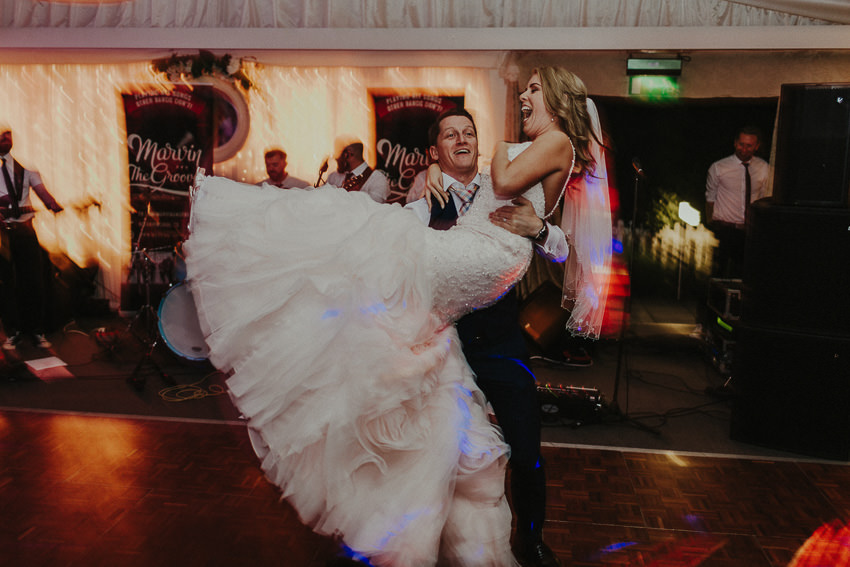 first dance in Coolbawn Quay - Groom lifts his bride and spinn around the dancfloor