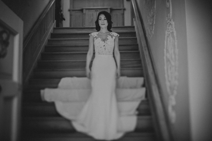 becky's portrait on the stairs aith amazind long dress