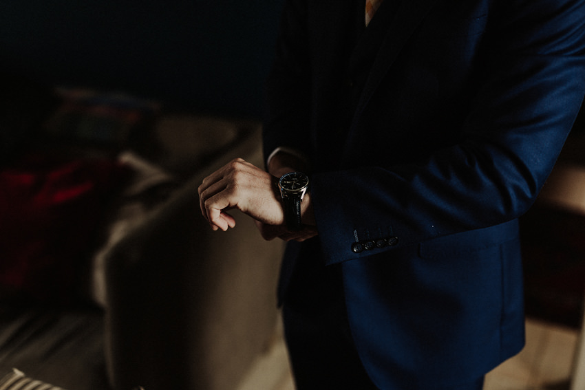 Groom is putting his gift - watch on his hand