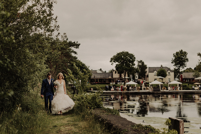 Wedding photo of the couple from coolbawn Quay with view on the all venue