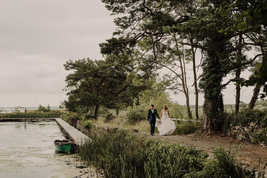 beautiful sceninc portrait from coolbawn quay with wedding couple and green boat