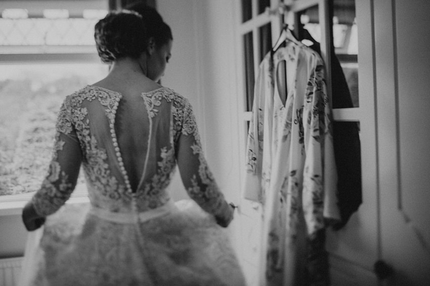 Maureen putting her dress on - black and white documentary picture
