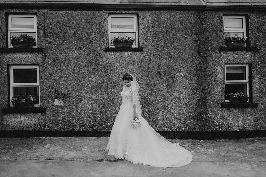 blacj and white rustic portrait of the bride at the old house