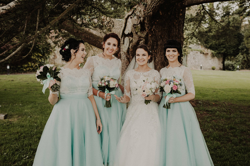 natural group pictures of bridesmaids with bride, beautiful blue dresses
