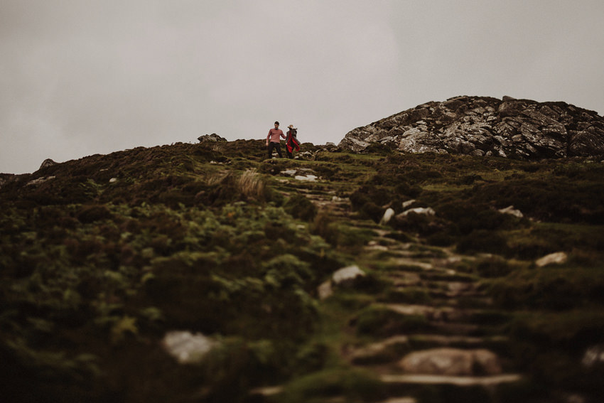 couple is walking down the stone stairs