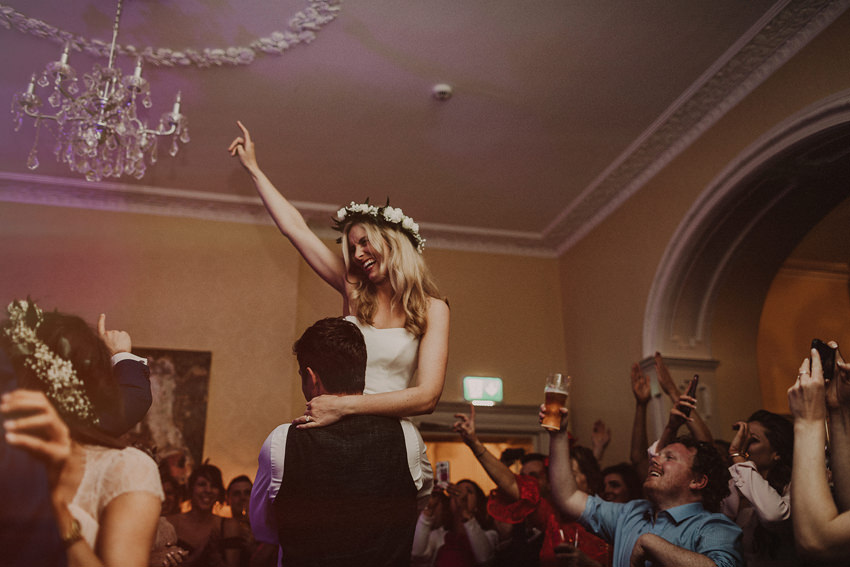 epic first dance at the wedding groom lifts bride
