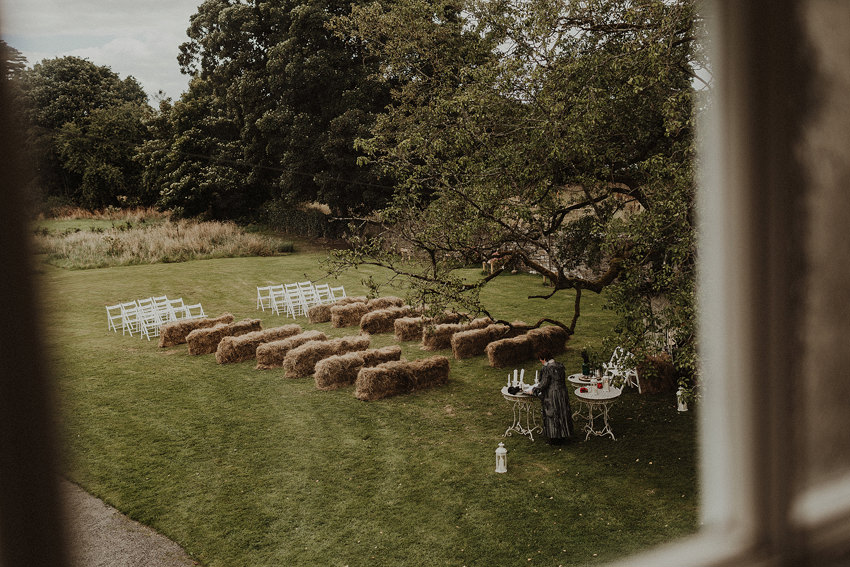 wedding ceremony under the three on the hay bales