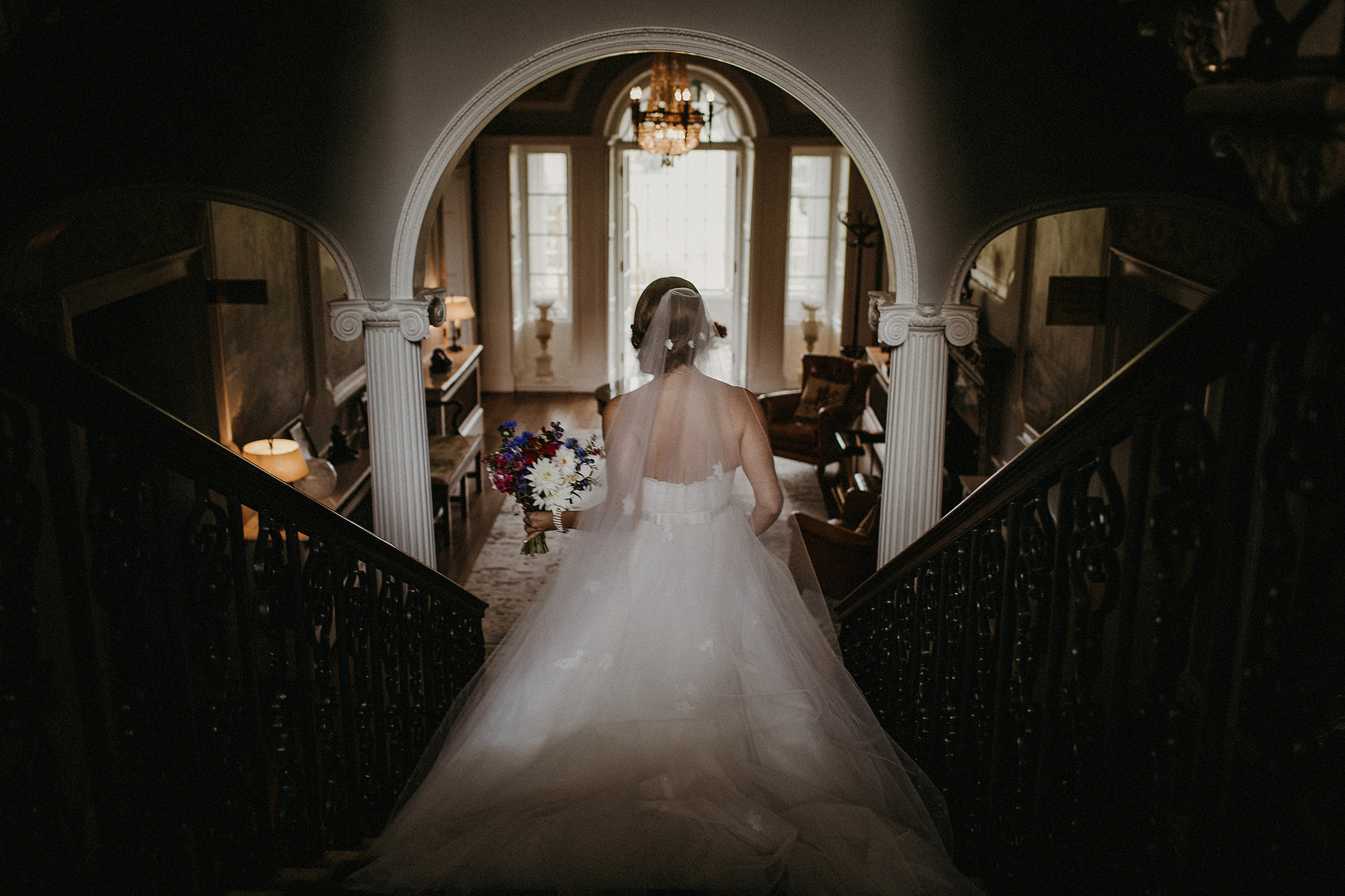 bride is walking down the stairs artistic ans documentary photo mount juliet estate kilkenny