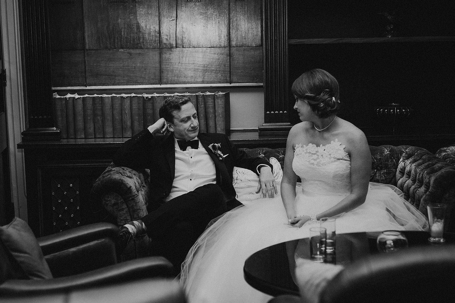 perfectly captured moment of bride and groom sitting on the sofa and having a relaxed chat before the first dance